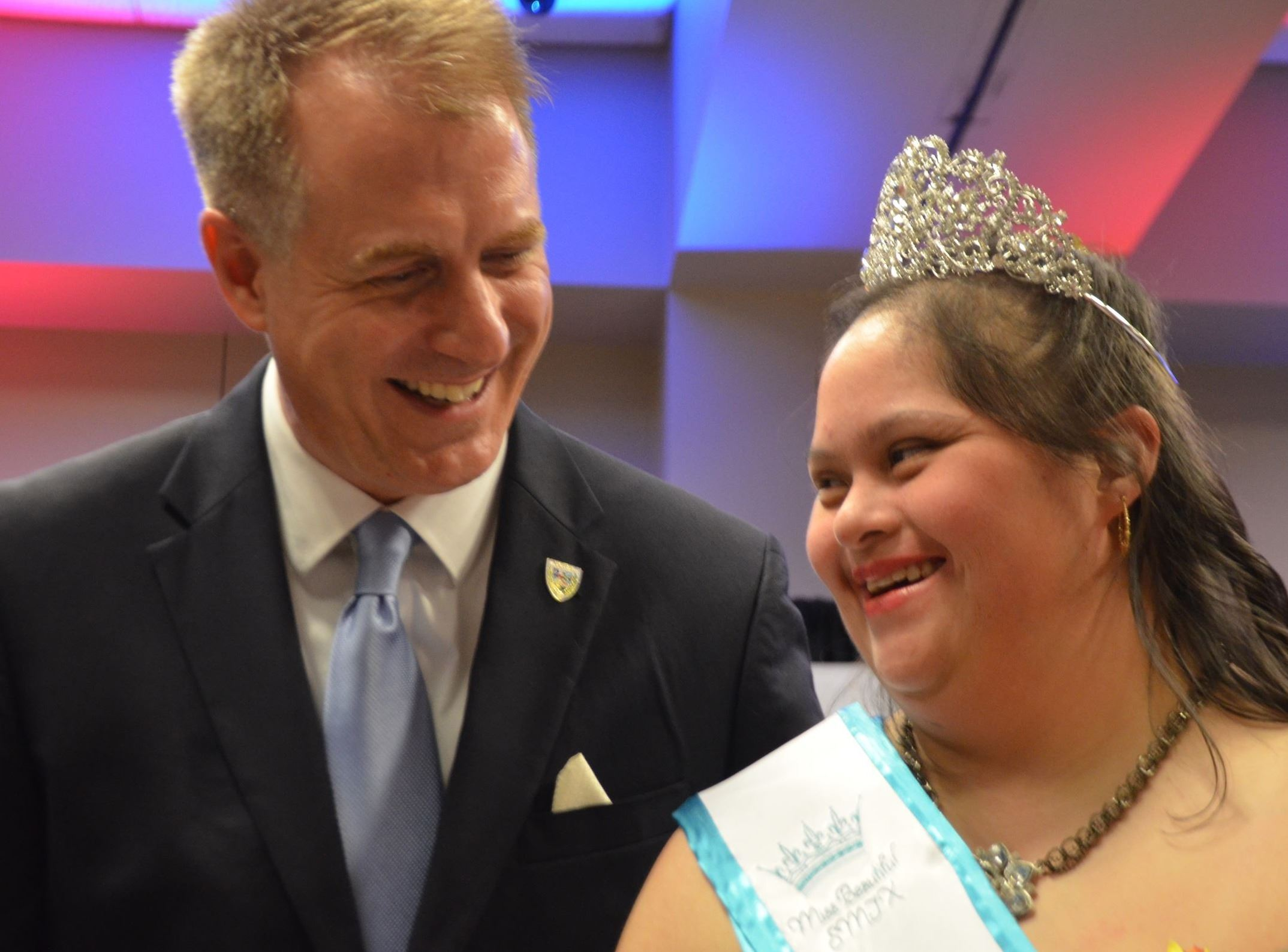 John Thomaides smiles with Elsa Sanchez, Miss Beautiful SMTX 2019