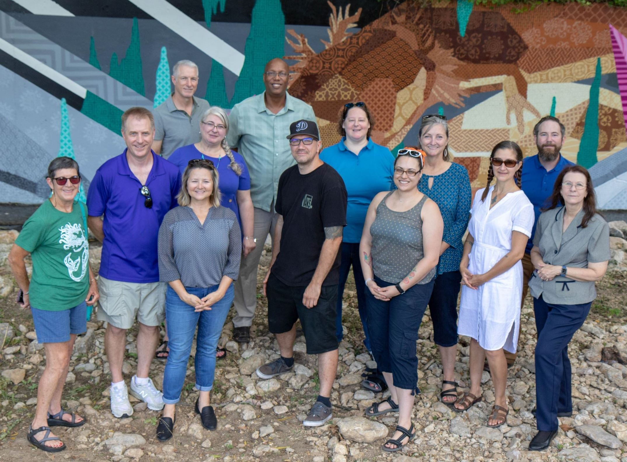 People from community standing in front of Sessom Drive Mural. Front row from left are Pam Dever, Jo