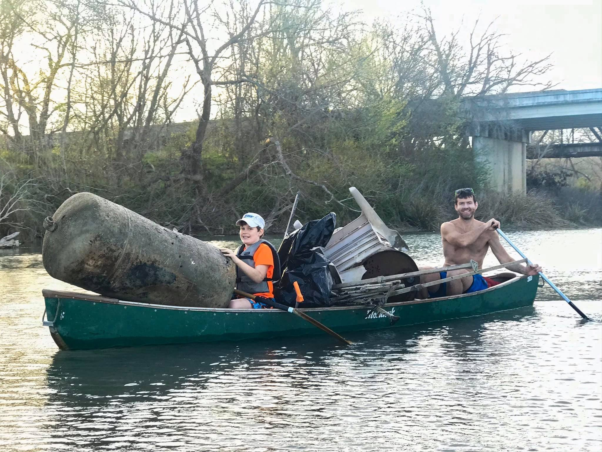 Canoe with large tank during Great Texas River Cleanup 2020