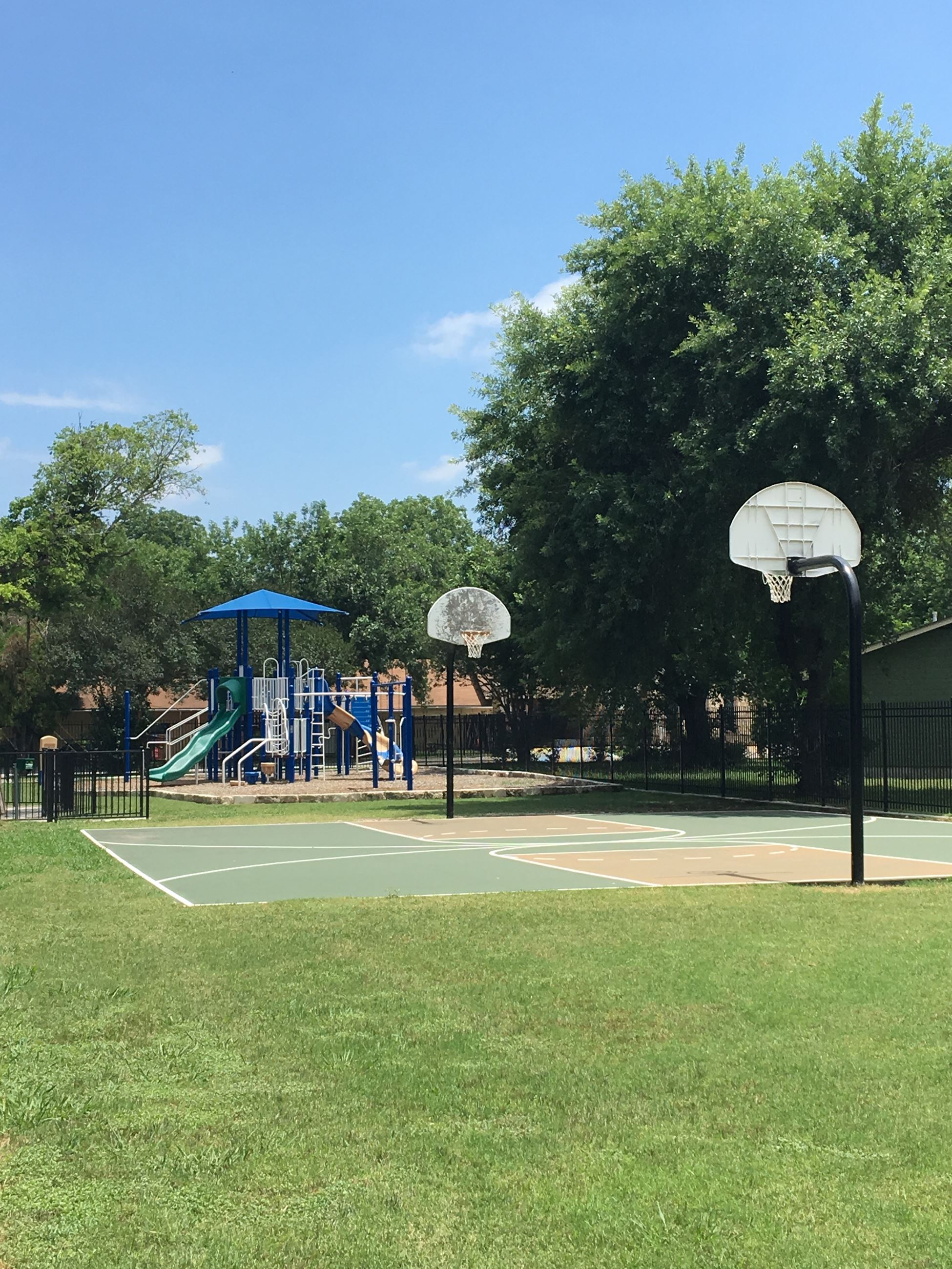 photo of basketball court and playground