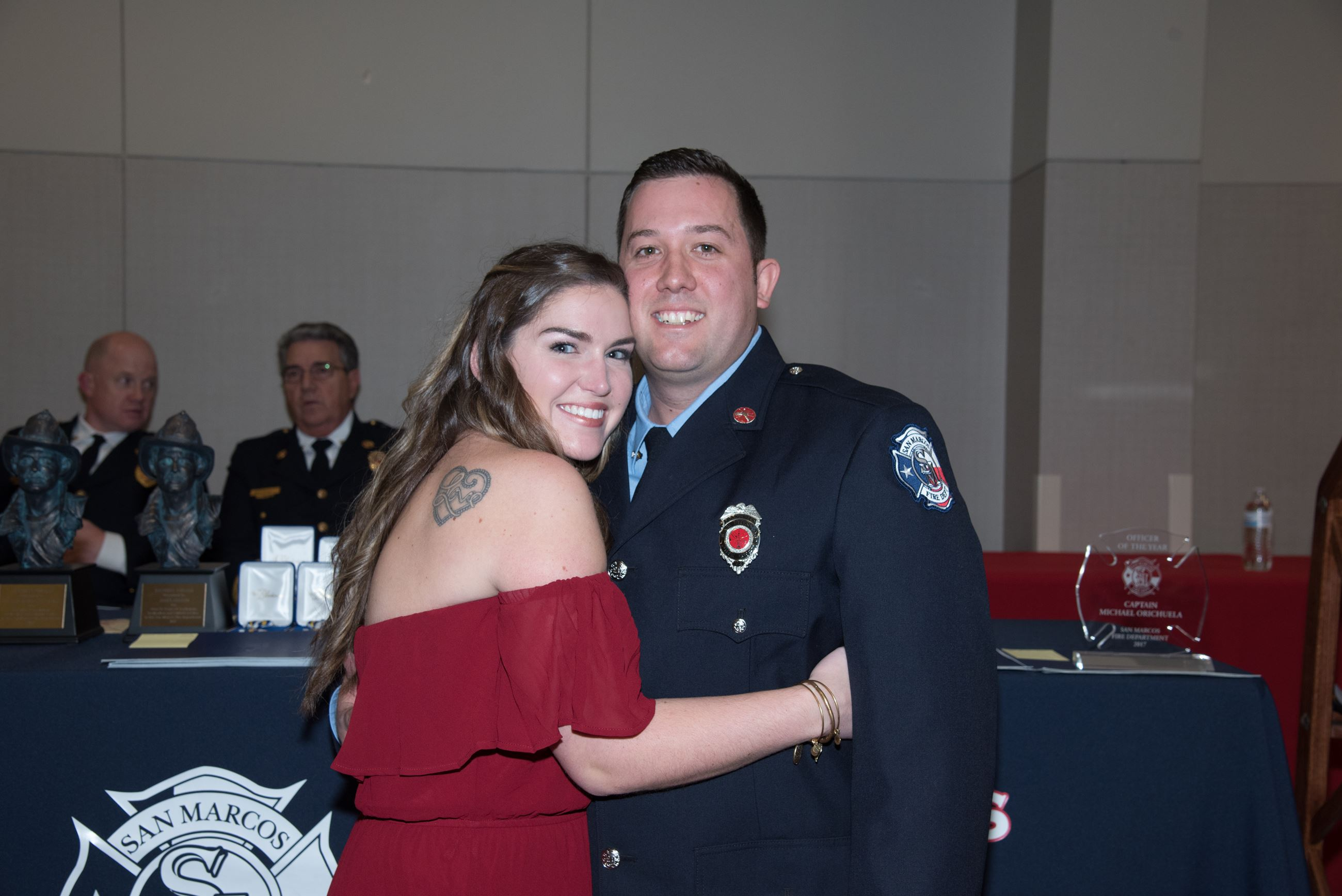 Firefighter getting pinned with his promotional badge.