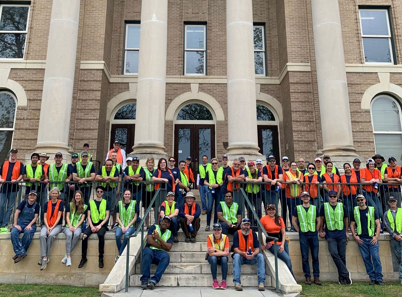 LCRA team standing in front of Hays County Courthouse