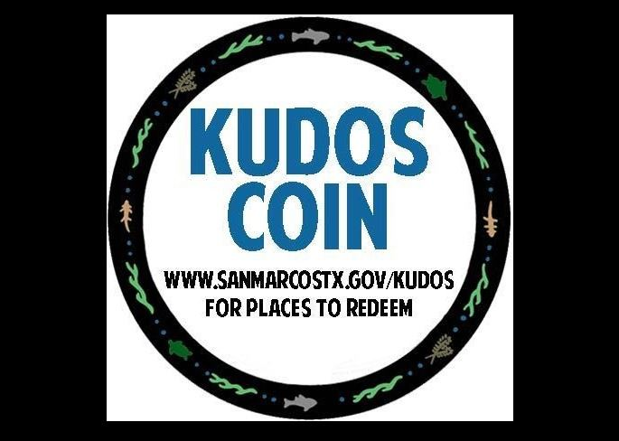 "Kudos Coin graphic - black exterior outline with fish and wave pattern, inside reads ""Kudos Coin"