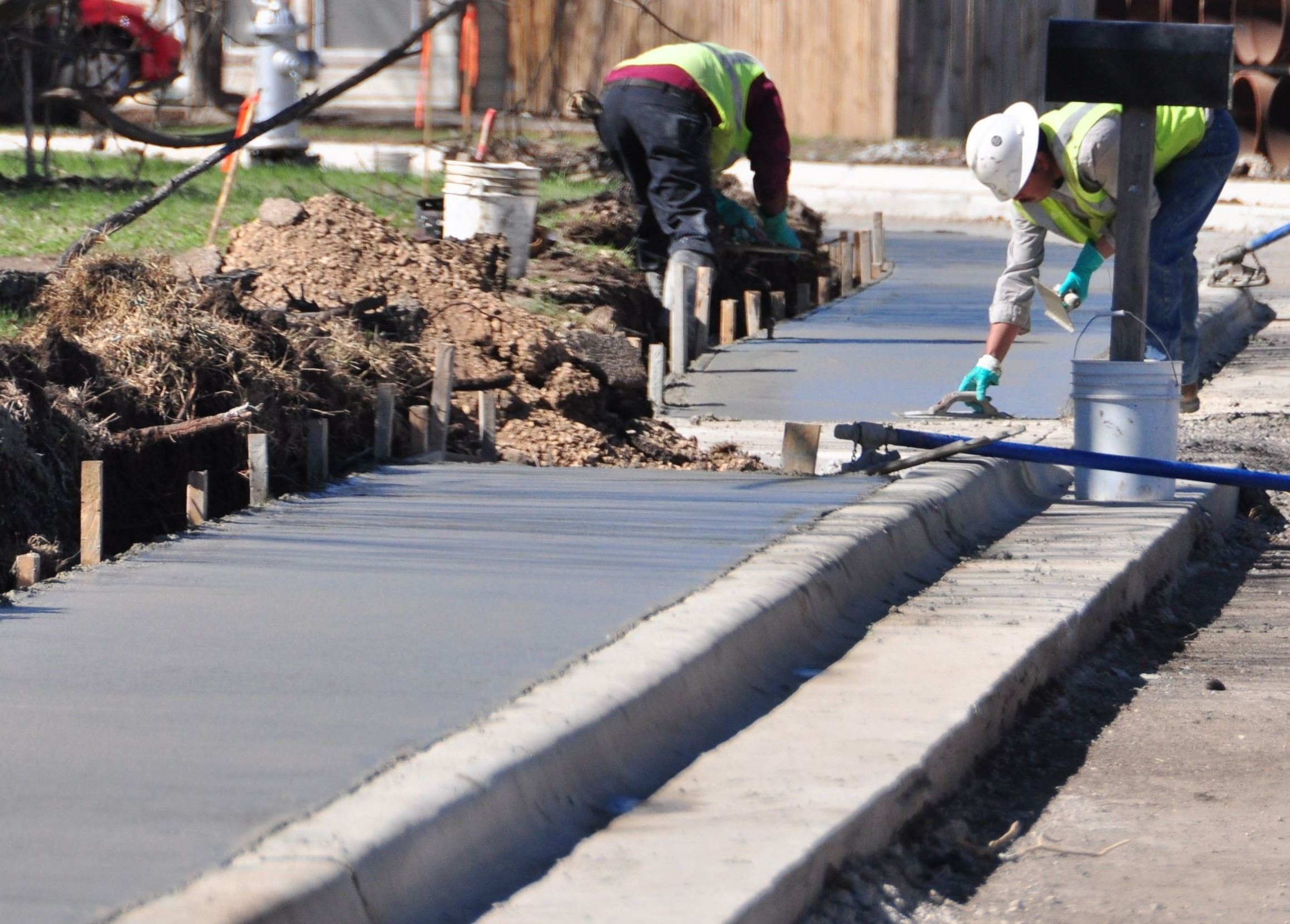 Photo of employees installing sidewalk