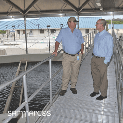 Photo of utility staff standing on platform at San Marcos Surface Water Treatment Plant