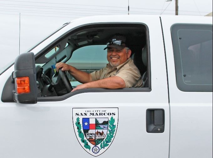 Robert Cavasos standing in front of an animal protection truck