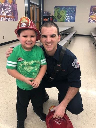 Firefighter Sweet with child