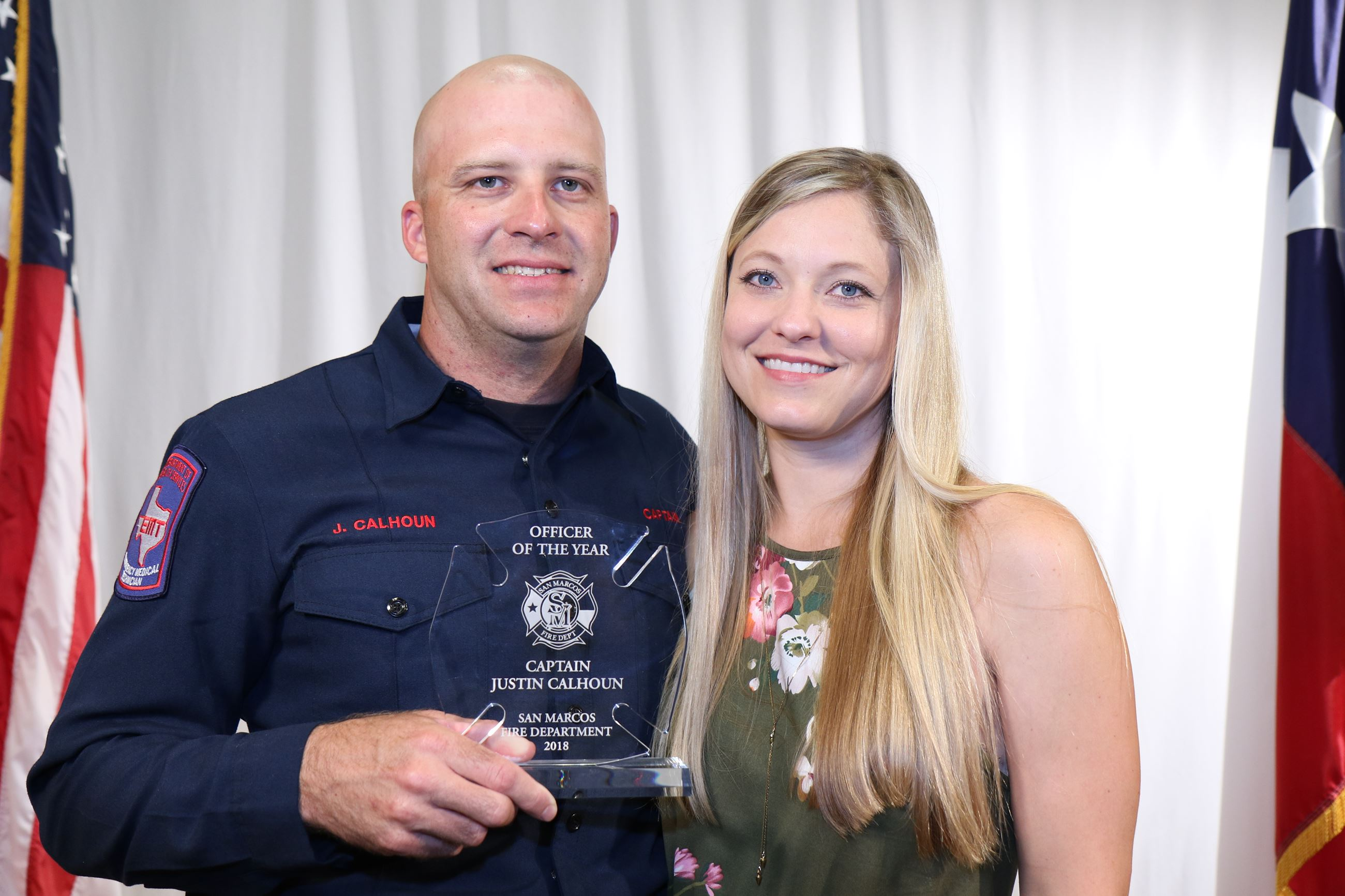 Captain Justin Calhoun received the prestigious award of Office of the Year. Pictured with his wife,